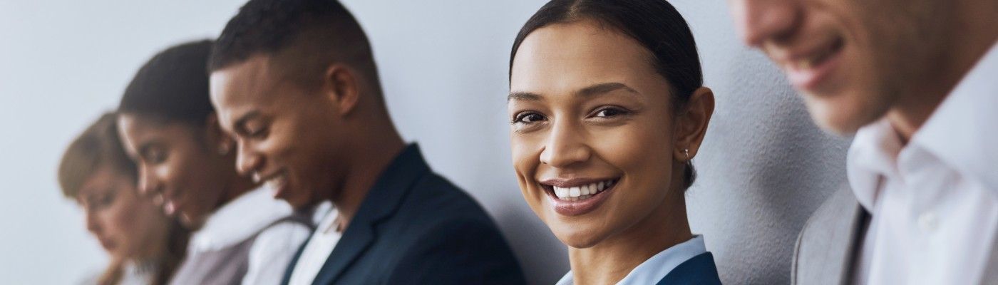 diverse business people with woman smiling