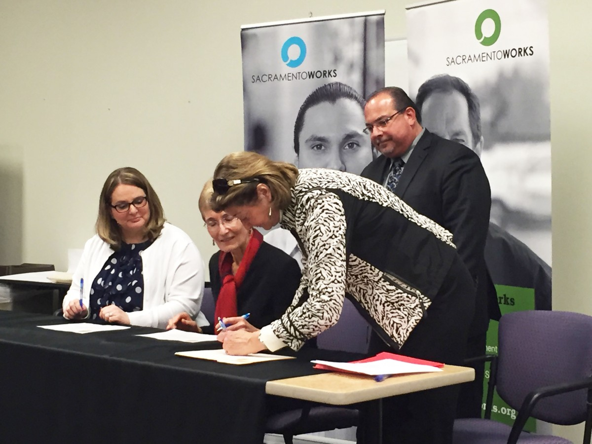 Apprenticeship provides a blueprint for the future college of kathy kossick executive director of the sacramento employment and training agency center seated at the table participates in the signing of state malvernweather Gallery