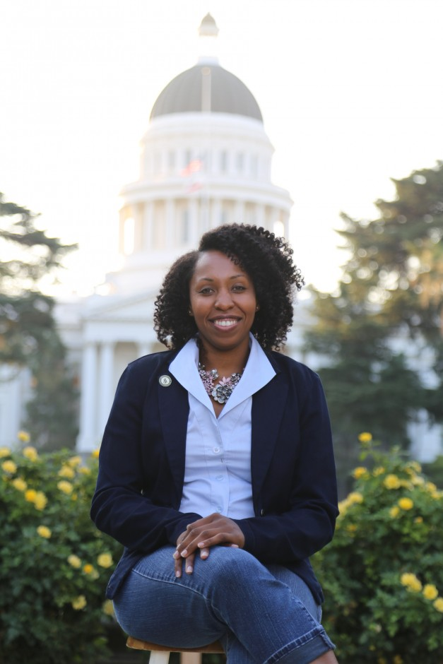 Veunta Dailey sits in front of the State Capitol building