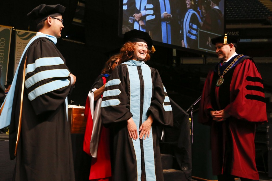 Caroline Turner, the Administrator-in-Charge at the College of Education, performed the hooding of doctoral degree candidate Esther Hattingh at the Spring 2016 Commencement. (Sacramento State/Jessica Vernone)